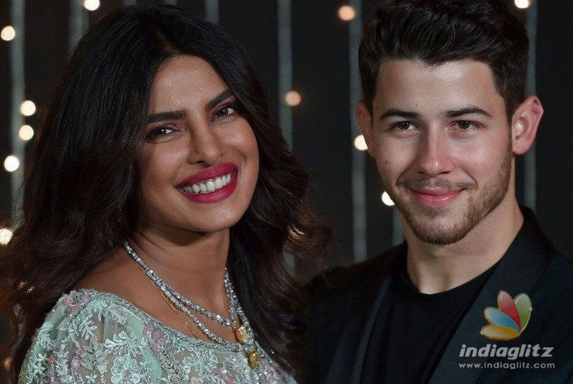Priyanka Chopra And Nick Jonas Throw Cakes At Fans!