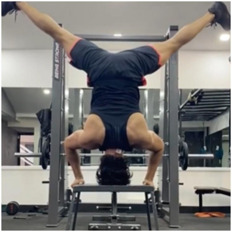 tovino headstand pose