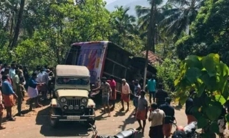 Bus carrying 70 wedding guests falls on top of house in Kerala