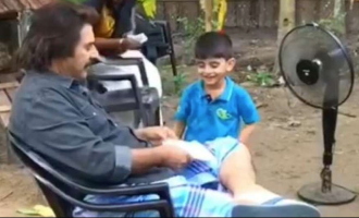WATCH: Mammootty makes a paper boat for a little boy at shooting location