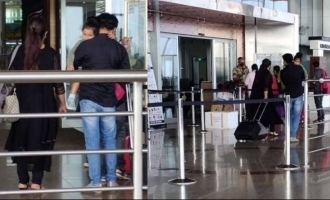Dileep and Kavya spotted with baby Mahalakshmi at airport