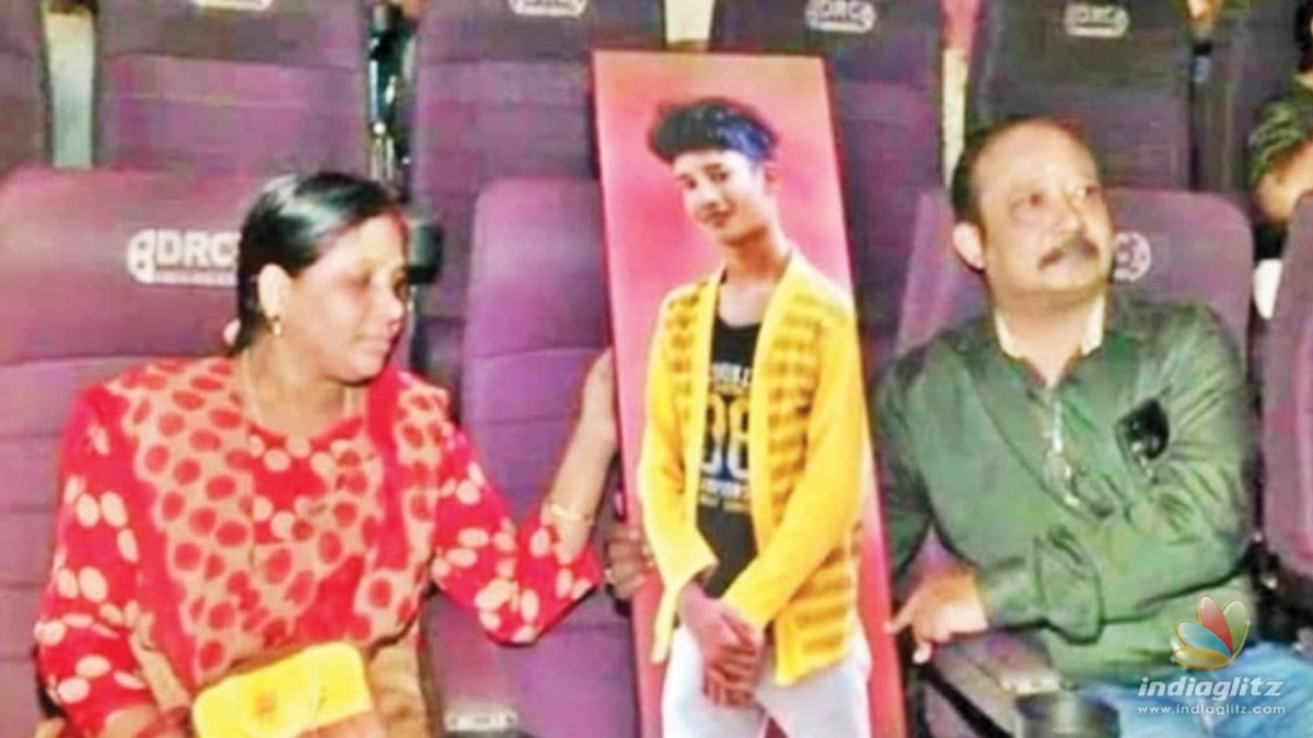 Malayalee family watch movie with life-size photo of their late son