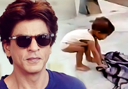 Shah Rukh Khan adopts two year old kid who innocently tried to wake his dead mother