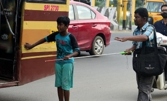 Lovely photos of 12 year old helping visually challenged person get bus turn viral!
