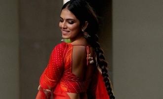 actress malavika mohanan latest in orange photos