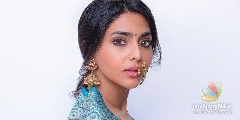 Dhanush heroine borrows her mothers saree and rocks in retro look
