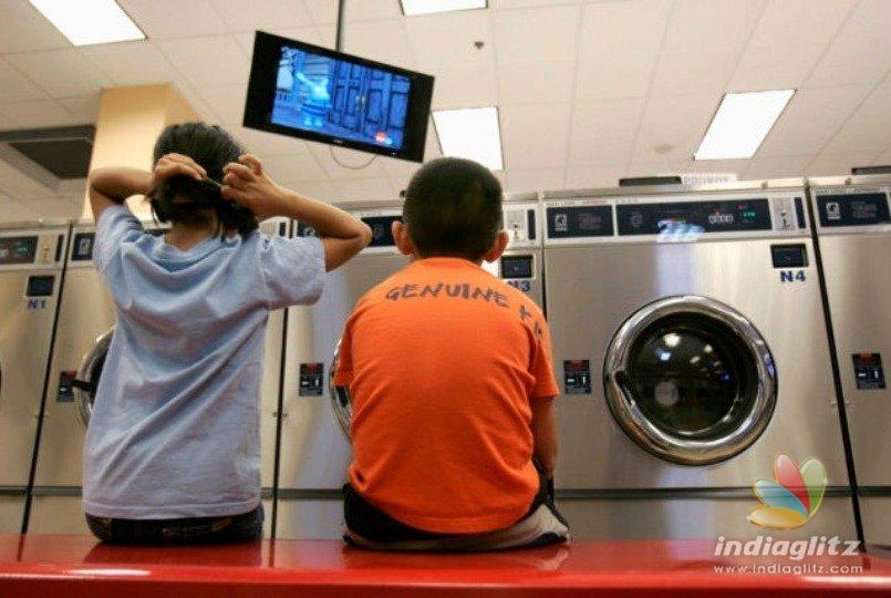 10 year old boy dies in freak washing machine accident