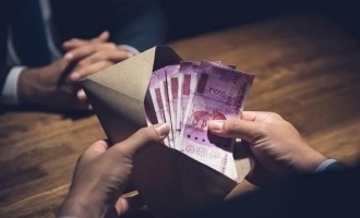 Income tax officer arrested for 14 lakhs bribe!