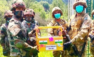 [PICTURES] Indian army exchanges sweets with Pakistan army on Eid