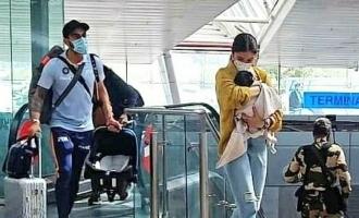 Kohli - Anushka Sharma's airport photo with their baby rocks internet!