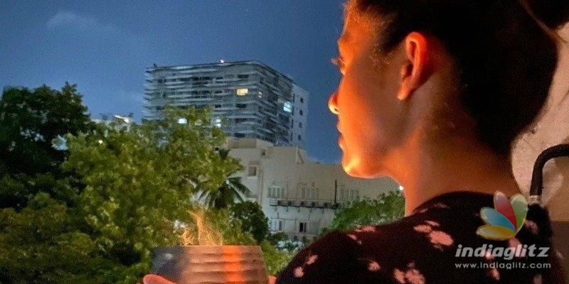 Nayanthara lights lamp and Vignesh Shivan questions science behind killing corona!