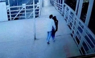 CCTV footage shows sexual abuser forcibly kissing and groping woman