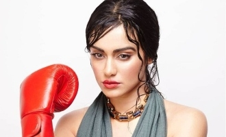 கொரோனாவை குத்துவிட்டு விரட்டும் நடிகை அதாஷர்மா!