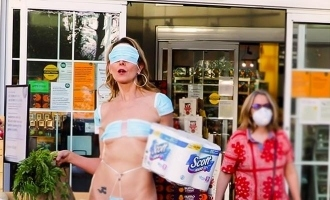 Woman wears bikini made of face mask to protest against coronavirus lockdown