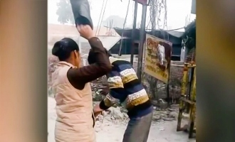 up kanpur female constable thrashes man with shoes harassing school girls hits 22 times