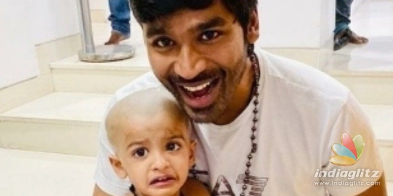 Dhanush does his duty as Thaai Maaman for his niece - Super cute pics out