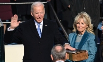 Biden targets Trumps legacy with first day executive actions