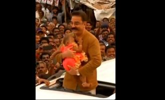Super Cute Video! Small baby refuses to let go of Kamal Haasan