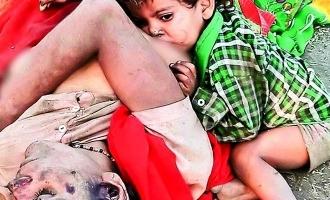 ரெயில்வே டிராக்கில் அன்னை இறந்தது தெரியாமல் பால் குடிக்கும் குழந்தை: அதிர்ச்சி புகைப்படம்