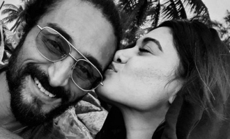 Is the man Oviya is kissing her lover?