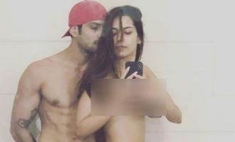 Hero releases wife's topless image