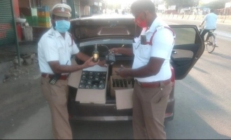 Tamil film producer arrested for smuggling illegal liqour bottles in fake police car