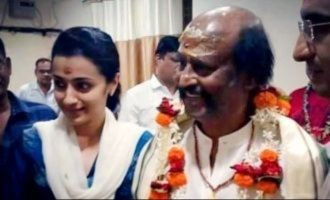 Trisha finds Rajini 'God-like' after temple visit