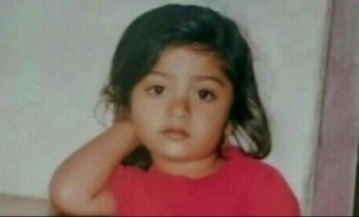 Do you know who this cute little girl is now and what she is waiting for?