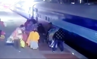 Video: Woman slips onto tracks while deboarding train