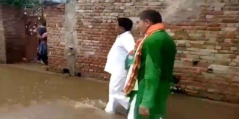 BJP MLA forced to walk in sewer water by angry villagers in Uttar Pradeshs Hapur – தமிழ் News