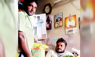 Vijay fan gives money donated by Vijay to Ajith fan!