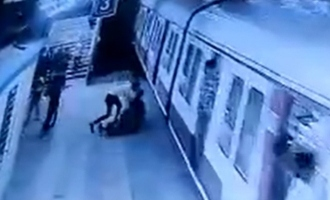 [VIDEO] Man tries to push woman under train for refusing to marry him; Caught on CCTV