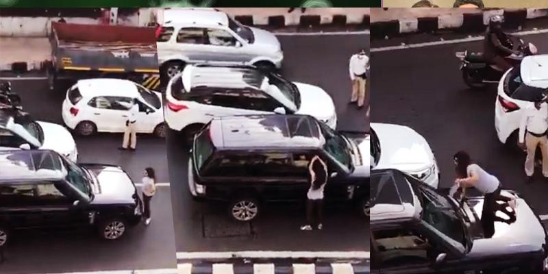 Couple's fight on road creates traffic block; wife sits on car bonnet -  Telugu News - IndiaGlitz.com