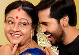 Parvateesam and Sri Lakshmi as 'Savitri W/O Satyamurthy'