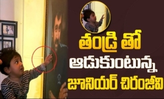 Junior Chiranjeevi Sarja looking at his father's photo in this cute video