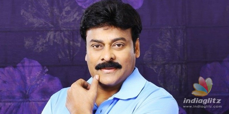 Micro artist inscribes Chiranjeevis image on a silver coin