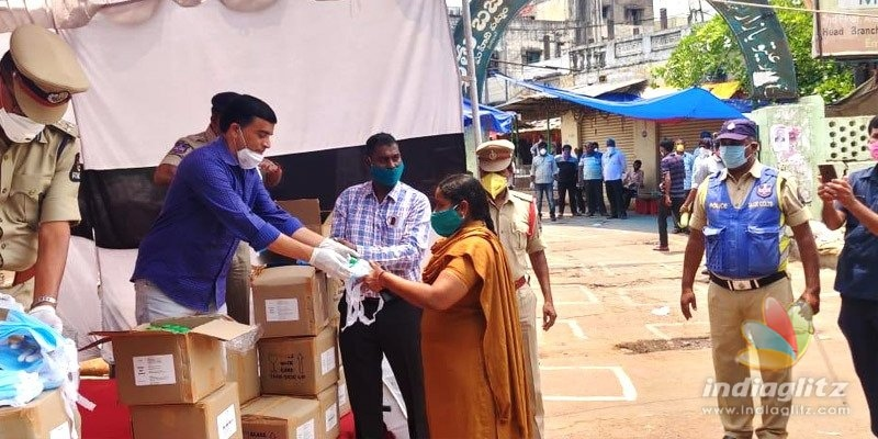Dil Raju distributes masks & more to police