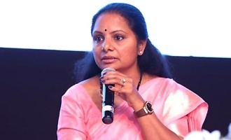 MP Kavitha falls down in an event