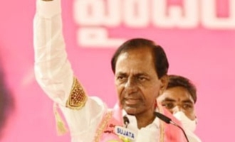 Activists protest while KCR speaking