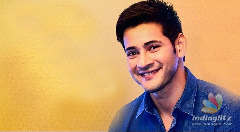 Mahesh cuddles up with children