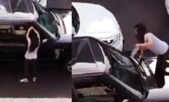 Couple's fight on road creates traffic block; wife sits on car bonnet
