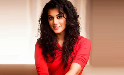 Whoa! Director on Taapsee's lap